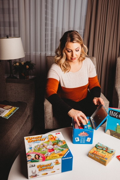 Kara Broks with a table of educational toys